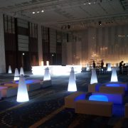Combination-of-Round-illuminated-table-and-White-Rectangular-poufs